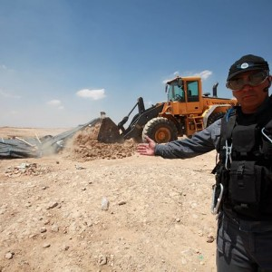 Al-Arakib, an unrecognized village of the Al-Turi Arab Bedouin tribe (8 km north of Beersheba), being demolished for the 54th time in August 2013. (Photo: Eloise Bollack)