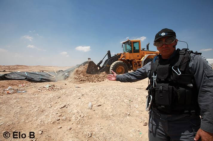 Al-Araqib, an unrecognized village of the Al-Turi Arab Bedouin tribe (8 km north of Beersheba), being demolished for the 54th time in August 2013. (Photo: Eloise Bollack)