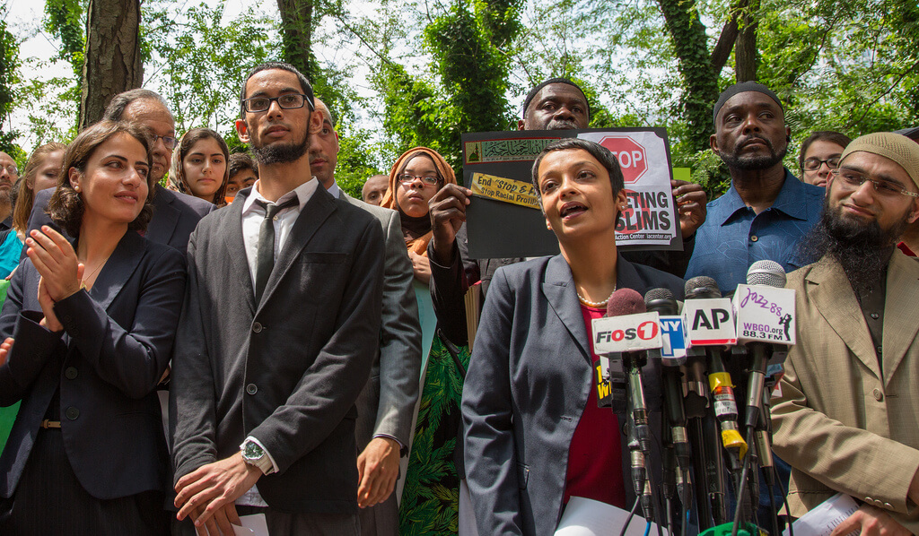 The ACLU is battling the NYPD over its surveillance program targeting Muslims. Above, the ACLU's Hina Shamsi announces the lawsuit alongside plaintiffs in June. (Photo via ACLU)
