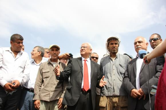 Saeb Erekat and Al-Makhoul villagers holding a press conference.