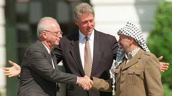 Yitzhak Rabin and Yasser Arafat shake hands on the White House lawn, September 13, 1993. (Photo: AP)
