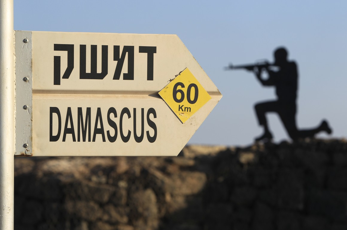 Sign showing the distance to Damascus and a cut out of a soldier at Mt. Bental in the occupied Golan Heights, overlooking Syria. (AP Photo/Tsafrir Abayov via Oxfam)