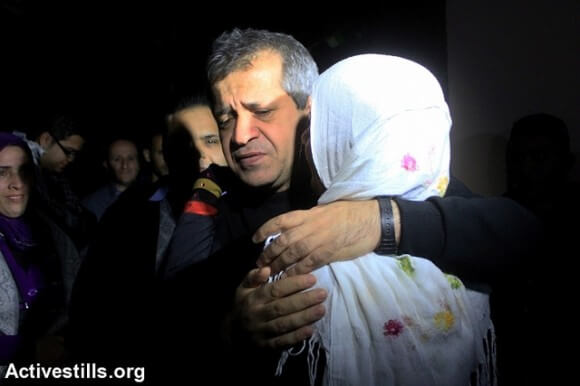 Mo'ayad Hajah meets his sister after he spent more than 22 years in Israeli prison. His mother died when he was in prison, Burqa, West bank, October 30, 2013. (Photo: Activestills)