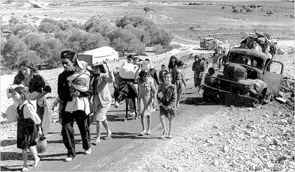 Palestinian refugees in 1948 leaving the Galilee. (Photo: Fred Csasznik/Wikimedia Commons)