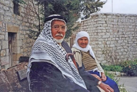 First generation refugees visiting their home in the depopulated village of Lifta, West Jerusalem. 2002 (Photo: BADIL Resource Center for Palestinian Residency and Refugee Rights)