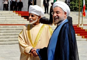 Iranian  President Hasan Rouhani, right, shakes hands with Omani Sultan Qaboos during an official arrival ceremony, in Tehran, Iran. Aug. 25, 2013 Photo: Hojjat Sepahvand, AP