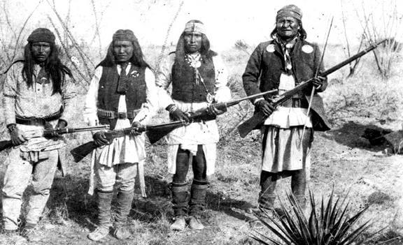 Geronimo, right, and other Apache warriors in 1886