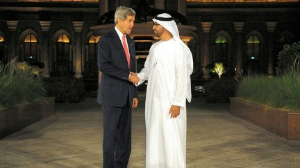 Description: Crown Prince Mohammed bin Zayed Al Nahyan of the United Arab Emirates welcomes Secretary of State John Kerry to a working dinner in Abu Dhabi on November 10, 2013. - State Dept Image