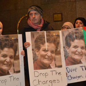 Supporters of community activist Rasmea Odeh hold up signs. (Photo via Samidoun.ca)