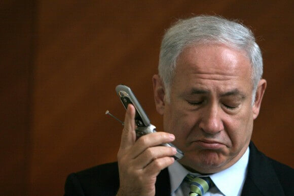 HELP CHEER UP THIS MAN!: Netanyahu getting the news that Israel doesn't have money to send him to South Africa.