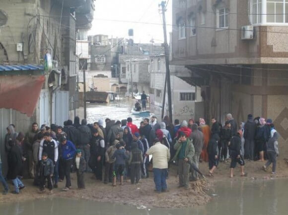 """Entire families trapped in their homes submerged since yesterday, no food, no water, no electricity. #Gaza"" December 13, 2013"