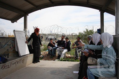 Classes held at an Israeli army checkpoint in the West Bank village Qalqilya, 2010 (Photo via Haitham Sabbah)