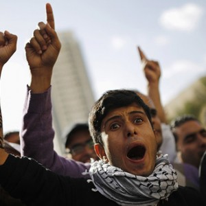 Members of the Bedouin community gesture during a protest outside a court in the southern city of Beersheba, calling to release people who were arrested last Saturday in protests against a government plan to force 40,000 Bedouins living in the southern Negev region to leave their villages, December 5, 2013. (Photo: REUTERS/Amir Cohen)