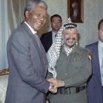 Nelson Mandela meets with Palestinian Liberation Organization Chairman Yasser Arafat, right, on Sunday, May 20, 1990 in Cairo. (Photo via news.naij.co)