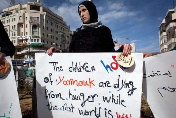 A Palestinian woman protests in Ramallah in solidarity with the Palestinian Yarmouk refugee camp in Syria. (Photo: Nasser Nasser/AP)