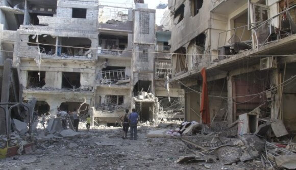 Ruined buildings in the Yarmouk refugee camp, summer 2013. (Photo: Reuters)