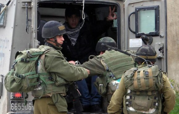 A Palestinian is arrested by Israeli soldiers following clashes during a demonstration in support with Palestinian prisoners jailed in Israeli prisons in February 2013. (Photo: Jaafar Ashtiyeh/AFP)