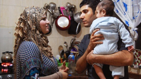 Ala'a Miqbel (shown here with his wife and their youngest son in their Gaza City apartment) was held for nearly four weeks in an Israeli prison, then released without charges. (Photo: NPR)