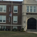 Long Island Jewish center with Israeli and American flags at half mast after Sharon's death, photo by Scott Roth