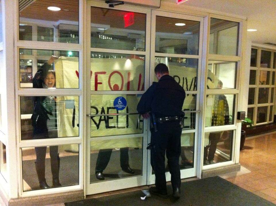Protesting Veolia's CEO at the Harvard Kennedy School.