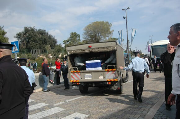 The coffin of Ariel Sharon leaving the Knesset in a humble exit after a state memorial,  13 January 2014. (Photo: Allison Deger)