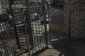 Metal gate crossing between City of David and Silwan. (Photo: Allison Deger)