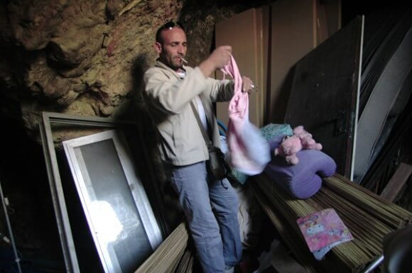Khalid Zir in his cave home, Silwan. (Photo: Allison Deger)