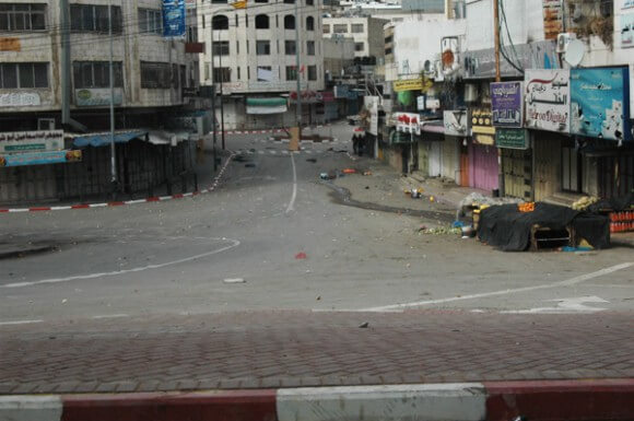 Palestinian shops closed during Open Shuhada Street protest. (Photo: Allison Deger)