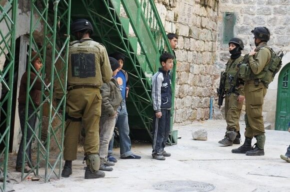 Israeli soldiers detaining Palestinian children in Hebron, the largest city in the West Bank, in 2012
