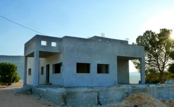 Sadeq's house just needs doors, windows, paint, tile, and plumbing to finish (Photo:Rebuilding Alliance)