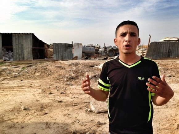 Adam Abu Alkin in his Bedouin-Arab village adjacent to Goldog cemetery. (Photo: Callie Maidhof)