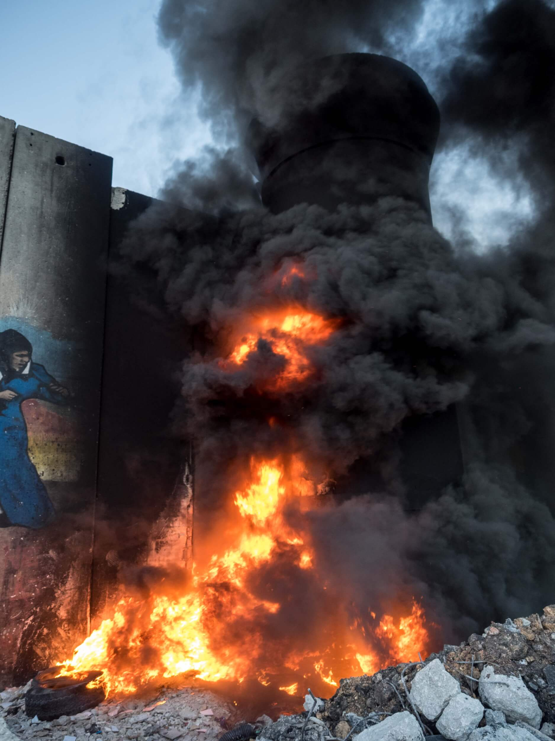 Tires set ablaze on the sniper tower (Photo: Dan Cohen)