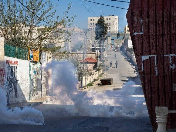 Israeli soldiers fire tear gas throughout the camp. (Photo: Dan Cohen)