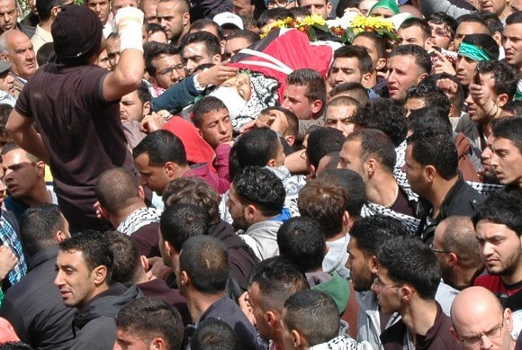 The funeral of Saji Darwish in the West Bank village of Beitin. (Photo: Allison Deger)