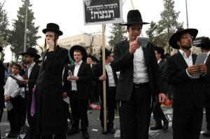 Ultra-Orthodox men protest Haredi draft bill in Jerusalem. (Photo: Allison Deger)