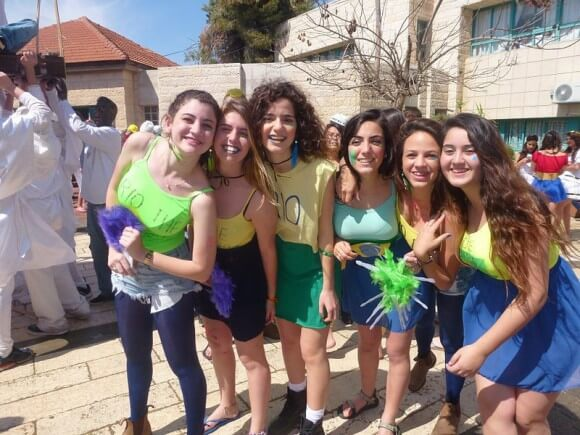 Purim carnival. KKK and black face costumed students in the left corner of the image. (Photo: Harel High School/Flickr)