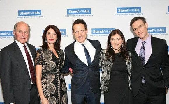 Myron Zimmerman (left), who funds both the Lawfare Project and StandWithUs, is pictured here with StandWithUs founders Esther Renzer and Roz Rothstein (second and fourth from left), along with Elon Gold and Bret Stephens. (StandWithUs fundraising gala, 2013)