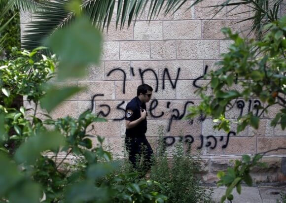 Hebrew graffiti on a Roman Orthodox Church in Jerusalem reads: 'King David, king of the Jews and Jesus is garbage'. May,9, 2014 (Photograph: Thomas Coex/AFP/Getty Images)