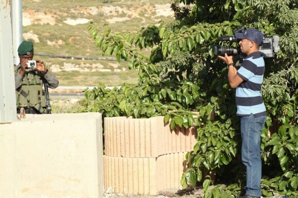 Palestinian cameraman filming an Israeli soldier himself filming the protestors during the World Freedom Press demonstration in Ramallah, 4th of May 2014. (Photo: Julie Pronier)