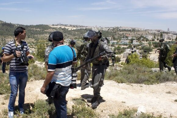 Palestinian journalists prevented from filming during Nakba Day commemoration in in al-Walaja – 15th of May 2014. (Photo: Julie Pronier)