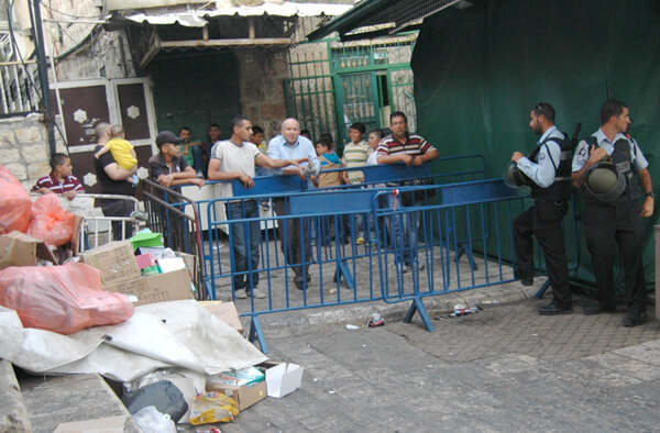Palestinian residents inside of the Old City barricaded from leaving their homes. (Photo: Allison Deger)