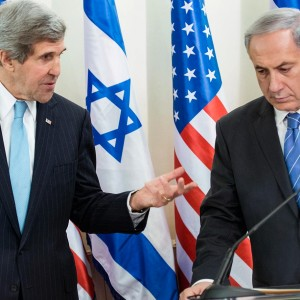 Israeli Prime Minister Benjamin Netanyahu  listens as US Secretary of State John Kerry makes a statement to the press before a meeting at the Prime Minister's Office on January 2, 2014 in Jerusalem. (Photo: BRENDAN SMIALOWSKI/AFP/Getty Images)