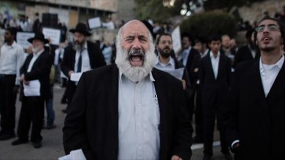 Ultra Orthodox Jewish men protest against Pope-Francis-upcoming-visit-to-the-Holy-Land-on-May-12-2014-in-the-Old-City-of-Jerusalem-AFP