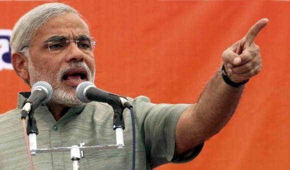 Narendra Modi speaks during an election campaign rally in Balasinor, Gujarat (Photo: Reuters)