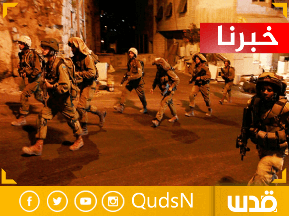 Israeli soldiers conducting arrests raids in Hebron, 18 June 2014. (Photo: Quds News Network)