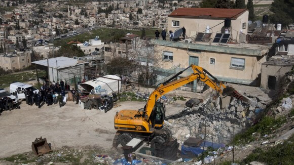 A bulldozer demolishes a Palestinian home in Jerusalem in February 2012. (Photo: Ahmad Gharabli/AFP/Getty Images)