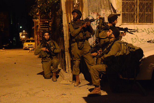 Israeli soldiers patrolling Hebron during its operation to find three missing Israelis. (Photo: Israel Defense Forces/Flickr)