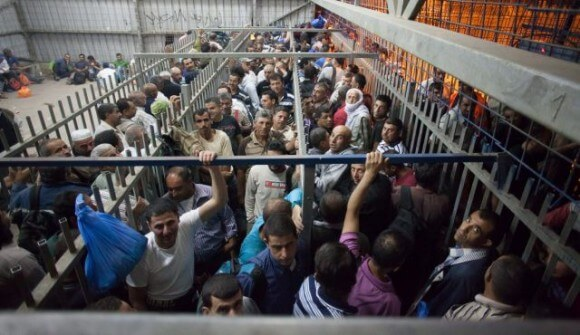 Palestinians on their way to work in Israel, at the Tarkoumia checkpoint, June 10, 2013.
