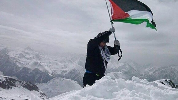 Palestinian mountain climber Mohammed AlQadi reaches the top of the Alps , April 2014