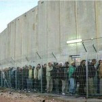 Photo of Palestinians at a checkpoint beside the wall. H/t KR twitter feed, and Scott Roth
